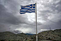 Pictured: A Greek flag flies by the rugged hills of the village of Valtetsi, Greece. <br /> Re: Preparations are under way to celebrate the 200 anniversary from the beginning of the Greek revolution of 1821, after an almost 400 year rule by the Ottoman empire, Athens, Greece.