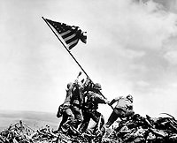 Flag raising on Iwo Jima.  February 23, 1945.  Joe Rosenthal, Associated Press.  (Navy)<br /> NARA FILE #:  080-G-413988<br /> WAR & CONFLICT BOOK #:  1221