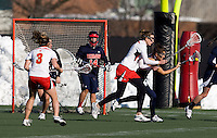 Laura Merrifield (9) of Maryland fights for the ball with Sam Tajirian (29) of Richmond at the practice turf field in College Park, Maryland.  Maryland defeated Richmond, 17-7.