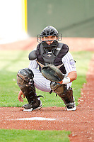 Grand Junction Rockies catcher Wilfredo Rodriguez (3) warms up his pitcher in the bullpen prior to the game against the Billings Mustangs at Suplizio Field on July 24, 2012 in Grand Junction, Colorado.  The Rockies defeated the Mustangs 4-3.  (Brian Westerholt/Four Seam Images)