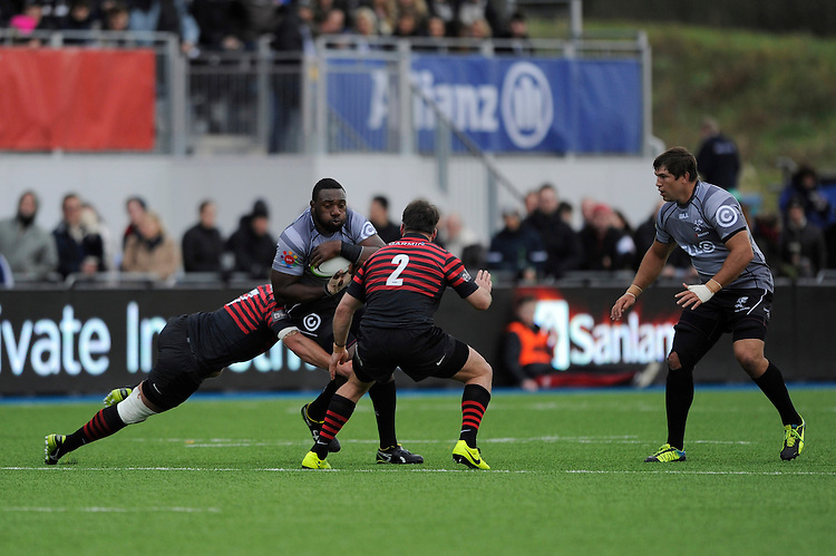 Tendai Mtawarira of Sharks is tackled by Jacques Burger (left) and Schalk Brits of Saracens during the Sanlam Private Investments Shield match between Saracens and the Cell C Sharks at Allianz Park on Saturday 25th January 2014 (Photo by Rob Munro)