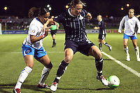 Abby Wambach#20 of the Washington Freedom holds off Chioma Igwe#2 of the Boston Breakers during a WPS match on April 10 2010, at the Maryland Soccerplex, in Boyds, Maryland.