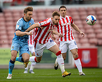 21st April 2021; Bet365 Stadium, Stoke, Staffordshire, England; English Football League Championship Football, Stoke City versus Coventry; Matt Godden of Coventry City and Rhys Norringrton-Davies of Stoke City chases a loose ball