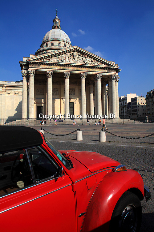 Pantheon with a red car in foreground. City of Paris. Paris