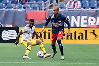 FOXBOROUGH, MA - MAY 16: Teal Bunbury #10 of New England Revolution intercepts the ball in front of Waylon Francis #14 Columbus SC during a game between Columbus SC and New England Revolution at Gillette Stadium on May 16, 2021 in Foxborough, Massachusetts.