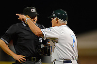 Vermont Lake Monsters manager Rick Magnante (7) argues a call with umpire Derek Moccia during a game against the Batavia Muckdogs on July 10, 2013 at Dwyer Stadium in Batavia, New York.  Batavia defeated Vermont 8-6.  (Mike Janes/Four Seam Images)