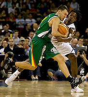 US center (12) Chris Bosh fights for the ball with Lithuania guard (13) Sarunas Jasikevicius while playing at the Cotai Arena inside the Venetian Macau Resort and Hotel.  The US defeated Lithuania, 120-84.