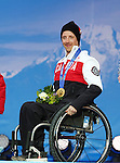 Sochi, Russia.15/03/2014- Canadian Josh Dueck celebrates his gold medal in the mens super combined sit skiing during the 2014 Paralympic Games in Sochi, Russia.Photo(Scott Grant/Canadian Paralympic Committee