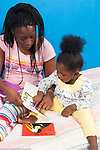 22 month old toddler girl with mother read to, child pointing and talking