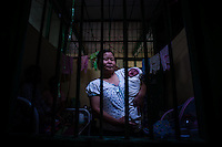 Mother holds her newborn child in one of the wards of small family hospital in Pyay. Usually wards in such hospitals are set in the same house where doctor lives or near it. It has up to 50 beds.