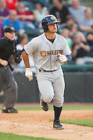 Mike Ford (26) of the Charleston RiverDogs hustles down the first base line against the Hickory Crawdads at L.P. Frans Stadium on May 24, 2014 in Hickory, North Carolina.  The Crawdads defeated the RiverDogs 7-3.  (Brian Westerholt/Four Seam Images)