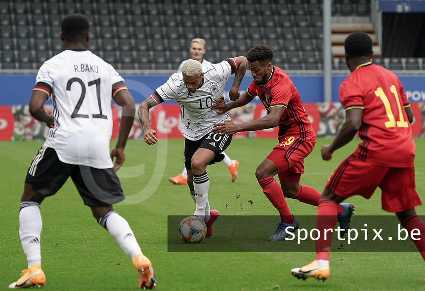 Germany's Lukas Nmecha (10) and Hannes Delcroix (19) battle for the ball during a soccer game between the national teams Under21 Youth teams of Belgium and Germany on the 5th matday in group 9 for the qualification for the Under 21 EURO 2021 , on tuesday 8 th of September 2020  in Leuven , Belgium . PHOTO SPORTPIX.BE | SPP | SEVIL OKTEM