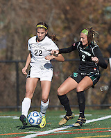 College of St Rose forward Gianna Smith (22) attempts to control the ball as Wilmington University defender Vikki Zipf (2) defends.. In 2012 NCAA Division II Women's Soccer Championship Tournament First Round, College of St Rose (white) defeated Wilmington University (black), 3-0, on Ronald J. Abdow Field at American International College on November 9, 2012.