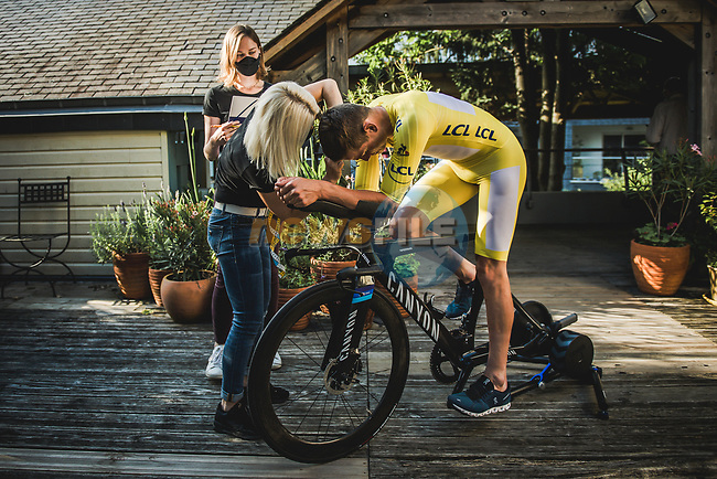 Race leader Mathieu Van Der Poel (NED) Alpecin-Fenix is measured up for his Yellow Jersey skinsuit by the seamstress' of Le Coq Sportif at the end of Stage 4 of the 2021 Tour de France, running 150.4km from Redon to Fougeres, France. 29th June 2021.  <br /> Picture: A.S.O./Pauline Ballet | Cyclefile<br /> <br /> All photos usage must carry mandatory copyright credit (© Cyclefile | A.S.O./Pauline Ballet)