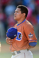 Durham Bulls shortstop Ray Olmedo (13) during the national anthem before a game against the Buffalo Bisons on July 10, 2014 at Coca-Cola Field in Buffalo, New  York.  Durham defeated Buffalo 3-2.  (Mike Janes/Four Seam Images)