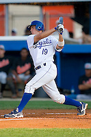 Travis Jones #19 of the Burlington Royals follows through on his swing versus the Bluefield Orioles at Burlington Athletic Park June 30, 2009 in Burlington, North Carolina. (Photo by Brian Westerholt / Four Seam Images)