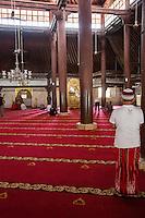 Yogyakarta, Java, Indonesia.  Interior of the Great Mosque, Masjid Gedhe Kauman, mid-18th. Century.  Men Gather for Mid-day Prayers.