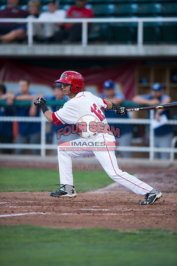 Orem Owlz right fielder Rayneldy Rosario (12) follows through on his swing during a Pioneer League game against the Ogden Raptors at Home of the OWLZ on August 24, 2018 in Orem, Utah. The Ogden Raptors defeated the Orem Owlz by a score of 13-5. (Zachary Lucy/Four Seam Images)