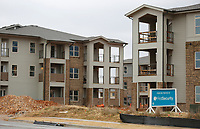 The construction of a 468-unit apartment community is visible Wednesday, January 6, 2021, near Arvest Ballpark in Springdale. The apartments are called the Trails at the Crossings. Check out nwaonline.com/210111Daily/ and nwadg.com/photos for a photo gallery.<br /> (NWA Democrat-Gazette/David Gottschalk)