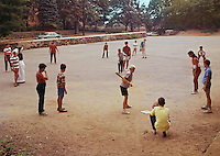 Saint John Villa Academy, NY, Students playing baseball on a dirt field