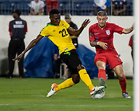 NASHVILLE, TN - JULY 3: Paul Arriola #7 attacks the goal while Devon Williams #22 defends during a game between Jamaica and USMNT at Nissan Stadium on July 3, 2019 in Nashville, Tennessee.