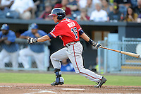 Rome Braves center fielder Kyle Wren #16 swings at a pitch during a game against the Asheville Tourists at McCormick Field on July 25, 2013 in Asheville, North Carolina. The Tourists won the game 9-6. (Tony Farlow/Four Seam Images)