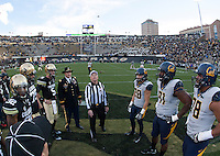 California and Colorado captains watch referee Jack Folliard tosses a coin during coin toss ceremony before the game at Folsom Field in Boulder, Colorado on November 16th, 2013.  Colorado defeated California, 41-24.