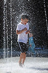 Kids play in the fountain at McFadden Plaza in Carson City, Nev. on Wednesday, June 7, 2017. <br /> Photo by Cathleen Allison/Nevada Photo Source