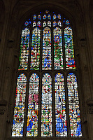 UK, England, Cambridge.  King's College Chapel, 16th. Century Stained Glass Window showing The Nativity, lower right.