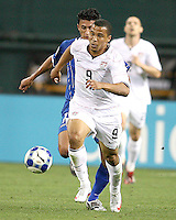 Charlie Davis #9 of the USA gets away from Mariano Acevedo #11 of Honduras during a CONCACAF Gold Cup match at RFK Stadium on July 8 2009 in Washington D.C. USA won 2-0.