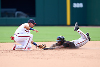 FCL Orioles Orange designated hitter Jose Berroa (18) is tagged out by second baseman Joseph Fernando (27) on a stolen base attempt during a game against the FCL Braves on July 22, 2021 at the CoolToday Park in North Port, Florida.  (Mike Janes/Four Seam Images)