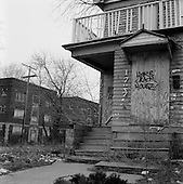 """East Cleveland, Ohio.March 25, 2008 ..In East Cleveland there are streets in which every home is boarded up and abandon after foreclosure and eviction. Junkies, drug dealers, squatters and the homeless are known to inhabit these buildings and the area has become extremely dangerous. Some residents refer to it as """"Mad Max"""" and claim that anything can be purchased here: children, drugs, women...Murder is also very common in this district."""