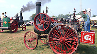 Thirteen-year-old Stephen McIntyre, right, drives Little Lady, a steam tractor based in Richmond.  Little Lady was one of many tractors with steam engines on display at the annual Pasture Party at Fairfield Dairy in Somerset, VA.  The large show features a carnival, crafts, and large and small steam engines.  An entrance donation of four dollars will go towards various local scholarships and charities.  The show will run from dawn until dusk on Saturday and Sunday.