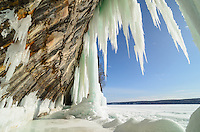 The colorful sandstone cliffs and icicles of the Grand Island ice caves. Munising, MI