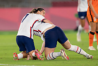 YOKOHAMA, JAPAN - JULY 30: Tobin Heath #7 of the USWNT celebrates a goal with Samantha Mewis #3 during a game between Netherlands and USWNT at International Stadium Yokohama on July 30, 2021 in Yokohama, Japan.