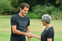 January 29, 2018: The 2018 Australian Open champion Roger Federer of Switzerland signs the visitor's book with the Governor of Victoria - Her Excellency the Hon Linda Dessau AC prior to posing for photographs with his trophy at Government House in Melbourne, Australia. Federer beat Cilic 3 sets to 2. Photo Sydney Low