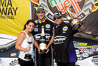 Jul. 28, 2013; Sonoma, CA, USA: NHRA pro stock driver Vincent Nobile (center) celebrates with father John Nobile (right) and sister Nicole Nobile after winning the Sonoma Nationals at Sonoma Raceway. Mandatory Credit: Mark J. Rebilas-