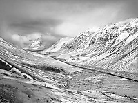 """""""The Dalton Highway in the Brooks Range"""" <br /> Alaska <br /> <br /> The Dalton Highway is a difficult 414 mile drive north of Fairbanks, Alaska. It crosses the Arctic Circle, travels through the Brooks Mountain Range, and ends at the Deadhorse workcamp, Prudhoe Bay and the Arctic Ocean. The Brooks Range is one of the most impressive mountain ranges that I have seen and I took several photographs of it including this black and white image which shows the Dalton Highway."""