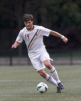 Boston College midfielder/defender Dylan Pritchard (14) brings the ball forward. Boston College (white) defeated Harvard University (crimson), 3-2, at Newton Campus Field, on October 22, 2013.