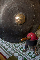 Yogyakarta, Java, Indonesia.  Gong in the Gamelan Orchestra at the Sultan's Palace.