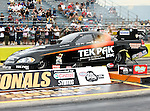 Dale Creasy Jr. #302, driver for Tek Pak/Beaver Shredding's Funny Car makes a qualifying run at the O'Reilly Fall Nationals held at the Texas Motorplex in  Ennis, Texas.