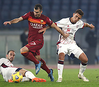 Football, Serie A: AS Roma - Cagliari calcio, Olympic stadium, Rome, December 23, 2020. <br /> Roma's Henrikh Mkhitaryan (c) in action with Cagliari's Christan Oliva (r) and goalkeeper Alessio Cragno (l) during the Italian Serie A football match between Roma and Cagliari at Rome's Olympic stadium, on December 23, 2020.  <br /> UPDATE IMAGES PRESS/Isabella Bonotto