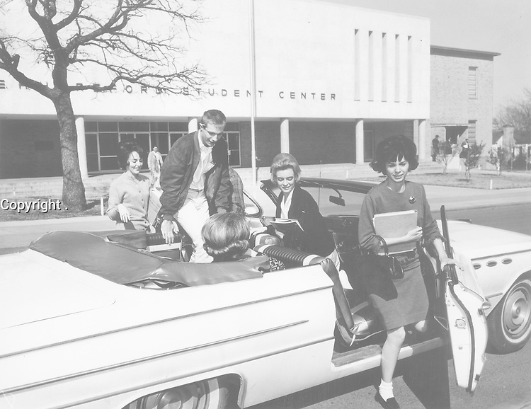 Arlington State College students in convertible car outside E.H. Hereford Student Center, Arlington State College [1949-1967], no date on photo