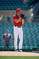 Rochester Red Wings starting pitcher Kohl Stewart (47) looks in for the sign during a game against the Lehigh Valley IronPigs on July 1, 2018 at Frontier Field in Rochester, New York.  Rochester defeated Lehigh Valley 7-6.  (Mike Janes/Four Seam Images)
