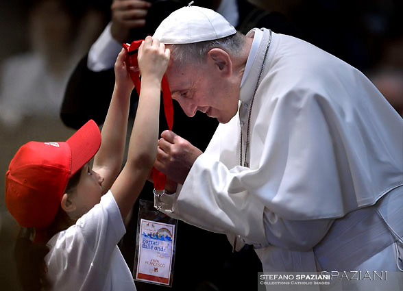 Pope Francis greets a child migrant during a meeting with 400 children from the south of Italy, Calabria, including children of migrants at the Vatican. May 28, 2016