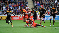 Seremaia Bai of Leicester Tigers mops up a loose ball as Elliot Daly of Wasps and Christian Wade of Wasps look on