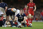 Scotland replacement scrum half Chris Cusiter spins the ball away from the breakdown.<br /> RBS 6 Nations 2014<br /> Wales v Scotland<br /> Millennium Stadium<br /> <br /> 15.03.14<br /> <br /> ©Steve Pope-SPORTINGWALES
