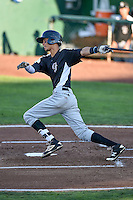 Pedro Gonzalez (22) of the Grand Junction Rockies follows through on his swing against the Ogden Raptors during the Pioneer League game at Lindquist Field on August 25, 2016 in Ogden, Utah. The Rockies defeated the Raptors 12-3. (Stephen Smith/Four Seam Images)