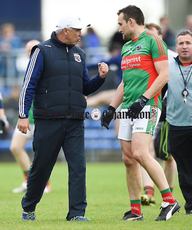 Kilmurry Ibrickane manager Aiden Moloney has a word with Peter O Dwyer ahead of their senior football final replay against Cratloe at Cusack park. Photograph by John Kelly.
