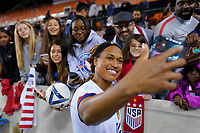 HOUSTON, TX - FEBRUARY 03: Jessica McDonald #14 of the United States takes a selfie with fans during a game between Costa Rica and USWNT at BBVA Stadium on February 03, 2020 in Houston, Texas.